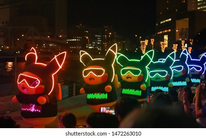 Yokohama, Japan - August 6 , 2019 - Pokémon character dance show during the Pikachu Outbreak event. Several dancers in Pikachu customes with light effects dance in the Nippon Maru Memorial Park
