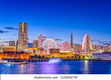 Yokohama, Japan city skyline from the bay at twilight.