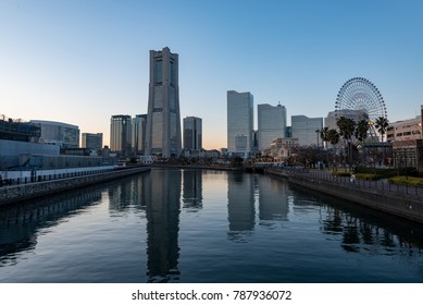 YOKOHAMA, JAPAN - December, 2017 : Yokohama Minato Mirai 21 seaside urban area in central Yokohama at dusk. Minato Mirai 21 is a seaside urban area in central Yokohama.