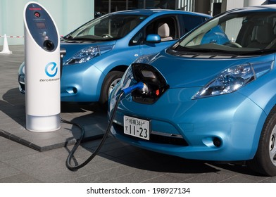 YOKOHAMA, JAPAN - December 4, 2011: A Nissan's electric car 'Leaf' is being charged at the charging station of the company's global headquarters located in Yokohama, Japan.