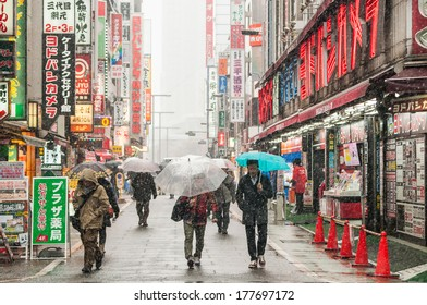 Yokohama, Japan - February 8, 2014: Japanese people walks across the street in snow storm in Yokohama, Japan