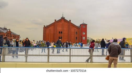 Yokohama, Japan. January 2018 - People ice skating at the Yokohama Red Brick Warehouse (Akarenga Soko)
