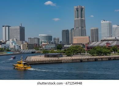 YOKOHAMA, JAPAN - June 17, 2017 : Panoramic view of Yokohama Minato Mirai 21 buildings from Osanbashi Pier. Minato Mirai 21 is a seaside urban area in central Yokohama
