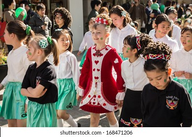 YOKOHAMA, JAPAN - March 16: Unidentified children join the parade for St. Patrick's Day at Motomachi street on March 16, 2013 in Yokohama, Japan.