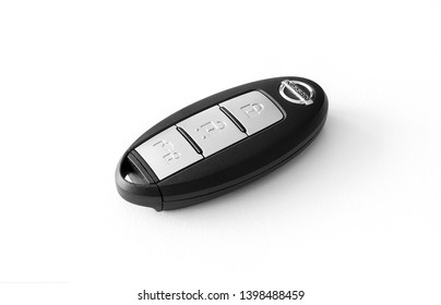 YOKOHAMA , JAPAN - MAY, 2019. Nissan Leaf wireless car key isolated on background. Keyless entry remote key to full electric vehicle. Device with buttons lock, unlock and open charge connector plug.