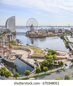 YOKOHAMA, JAPAN - MAY 3, 2017: An aerial view of the exciting Yokohama waterfront, including the famous sailing ship the Nippon Maru and the Yokohama Cosmo World amusement park.