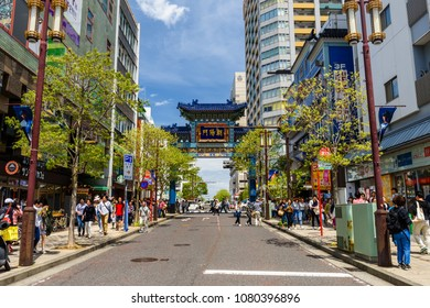 YOKOHAMA, JAPAN - MAY 6, 2017: Unidentified people travel at symbolic entrance gate of Yokohama China Town. Here is the largest China town in Japan.