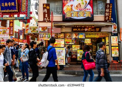 YOKOHAMA, JAPAN - MAY 6, 2017: Unidentified people buy icecream and sweet snack at Chinese restaurant in Yokohama Chinatown, Here is the largest China town in Japan.