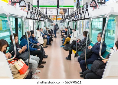 YOKOHAMA, JAPAN - NOVEMBER 7, 2016: People traveling by very popular Municipal Subway in Yokohama, Japan. Yokohama Municipal Subway is the metro network in the city of Yokohama, Japan