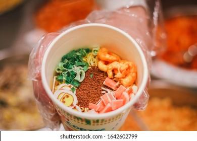 YOKOHAMA, JAPAN - OCT 16,2018 : Make cup noodles, order custom ingredients at The Cup Noodles Museum.
