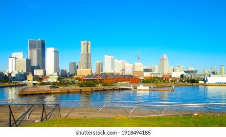 YOKOHAMA, JAPAN - October 23rd, 2019: Yokohama cityscape view from Osanbashi Pier. Yokohama is a popular tourist destination and a major commercial hub in the Greater Tokyo area.