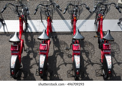 YOKOHAMA, JAPAN - SEPTEMBER 25, 2016: Rental E-bikes (bicycles assisted by electric motors) are parked in a row at a docking port. The bicycles are called Baybike which is a system of bicycle sharing.