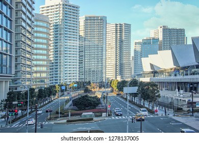 Yokohama, Japan-January 3, 2018: Front view of a broad avenue in the downtown. There are tall multi-story residential buildings on the left and Pacifico Yokohama Exhibition Halls on the right.