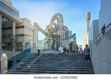 Yokohama, Japan-January 3, 2018: Moku Moku Waku Waku Yo-Yo (1994), a stainless steel installation between Landmark Plaza and the neighboring Queen's Tower. The serpent structures coils in the air.