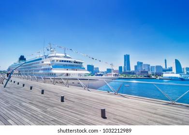 YOKOHAMA, KANAGAWA / JAPAN - MAY 21 2017 : A landscape of a luxurious passenger boat and a Yokohama Minato Mirai who is anchored in the Great Pier.