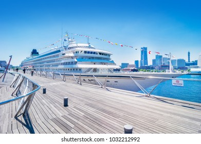 YOKOHAMA, KANAGAWA / JAPAN - MAY 21 2017 : A landscape of a luxurious passenger boat and a Yokohama Minato Mirai who is anchored in the Great Pier.