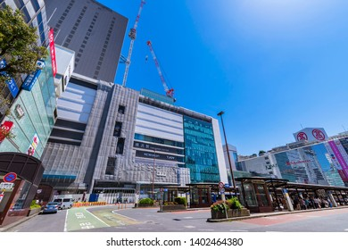 """YOKOHAMA, KANAGAWA / JAPAN - MAY 8 2019 : Landscape of the """"Yokohama Station"""" west entrance. Construction work on a new station building is in progress. The new building is scheduled to open in 2020."""