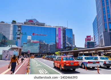 """YOKOHAMA, KANAGAWA / JAPAN - MAY 8 2019 : Landscape of the """"Yokohama Station"""" west entrance. There is a large bus terminal and a taxi stand in front of the station."""