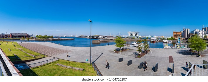 "YOKOHAMA, KANAGAWA / JAPAN - MAY 8 2019 : Landscape of ""Zou-no-hana Park"" in Yokohama. Panoramic view. A park facing the sea, overlooking the Great Pier and Minatomirai. Many tourists visit."