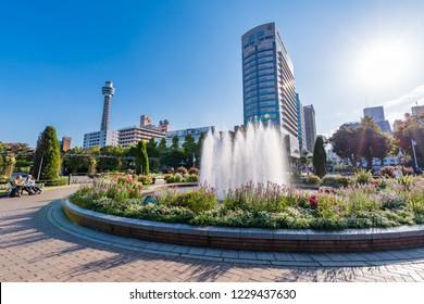 "YOKOHAMA, KANAGAWA / JAPAN - OCTOBER 28 2018 : Scenery of ""Yamashita Park"" in Yokohama. There is a statue of ""guardian of water"" and a fountain square."
