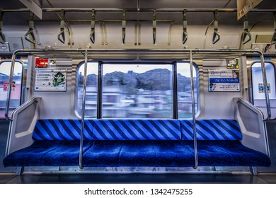 Yokohama, Kanagawa Prefect / Japan – March 10, 2019:  Looking out the window of a train speeding through the countryside.