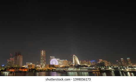 YOKOHAMA, KANAGAWA PREFECTURE, JAPAN - May 13, 2019: Night view of Minato Mirai 21 district, featuring many of its famous sights such as Landmark Tower, Cosmo Clock 21 and the Red Brick Warehouse.