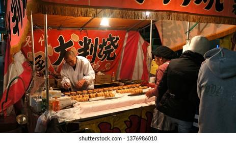 YOKOHAMA, KANAGAWA PREFECTURE, JAPAN - NOVEMBER 29, 2015: Obanyaki yatai stall at Kotohira-otori shrine's Tori-no-Ichi festival. Obanyaki, also called imagawayaki, is a sweet with azuki bean paste.