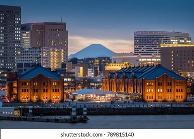 Yokohama red brick warehouse with Top of Mt. Fuji in background. The Yokohama Red Brick Warehouse, a major tourist spot in Yokohama