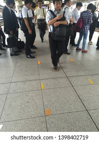 Yokohama,KANAGAWA/Japan-June 16 2016:Yokohama Station. in the yellow line to keep the aisle open for people who move to the back, those who handle smartphones and those who line up for the next train.