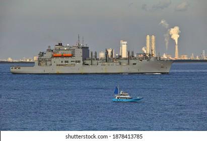 YOKOSUKA CITY, KANAGAWA PREFECTURE, JAPAN - DECEMBER 18th, 2020: USNS Charles Drew (T-AKE-10), a Lewis and Clark-class Dry Cargo Ship, Sailing through the Uraga Channel in Tokyo Bay toward the Pacific