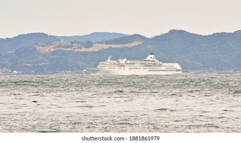 """YOKOSUKA CITY, KANAGAWA PREFECTURE, JAPAN - DECEMBER 24th, 2020: """"Pacific Venus,"""" a Luxury Cruise Ship, Sailing through the """"Uraga"""" Channel into Tokyo Bay in the Time of Adversity Caused by COVID-19"""