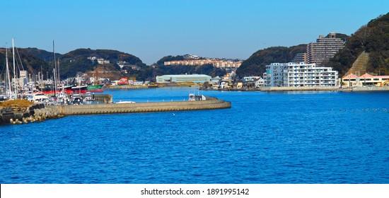 "YOKOSUKA CITY, KANAGAWA PREFECTURE, JAPAN - JANUARY 4th, 2021: The Bay of ""Uraga"" and its Surroundings Viewed from Point ""Tomyozaki"""