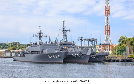 YOKOSUKA, JAPAN - MAY 4, 2017: A squadron of Japan Maritime Self-Defense Force minesweepers are moored closely together at the huge Yokosuka Naval Port.