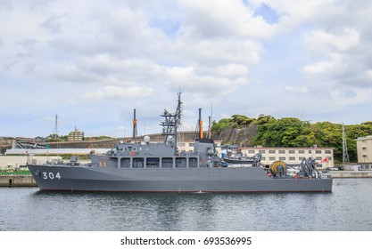 YOKOSUKA, JAPAN - MAY 4, 2017: A Japan Maritime Self-Defense Force minesweeper stands ready for an important task force mission at Yokosuka Naval Port.