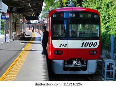 YOKOSUKA, KANAGAWA PREFECTURE / JAPAN - MAY 12, 2018: A View of Uraga Terminal of the Keikyu Main Line Just before the Departure of a New Type 1000, Local Train Bound for Shinagawa, Tokyo