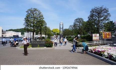 YOKOSUKA, KANAGAWA PREFECTURE, JAPAN - MAY 03, 2015: YOKOSUKA, KANAGAWA PREFECTURE, JAPAN - MAY 03, 2015: Visitors in a sunny day at Verny Park, located near JR Yokosuka Station.