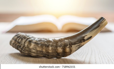 Yom Kippur, Rosh Hashanah (Hashana)  jewish New Year, Shemini Atzeret (Shmini Atzeret) and Simchat Torah holiday concept with shofar traditional Israel's ram horn with religious holy prayer book