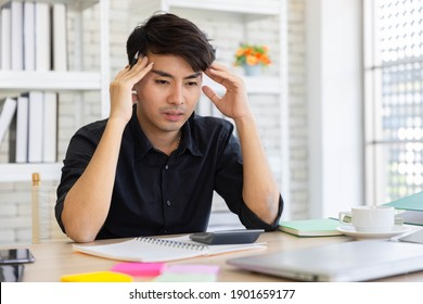 Yong Asian man having stressful time working from his home