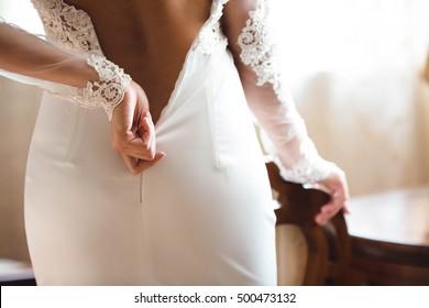yong bride wears her wedding white  dress