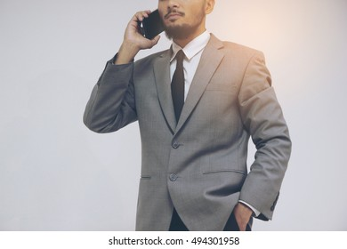 Yong businessman in suit talking on the phone