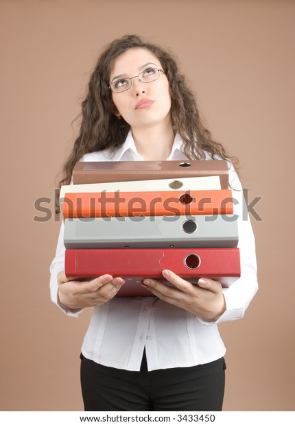 Yong businesswoman with folder isolated on white background
