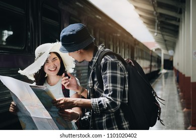 Yong Couple traveler with map because lost at train station. Travel and Active lifestyle concept.
