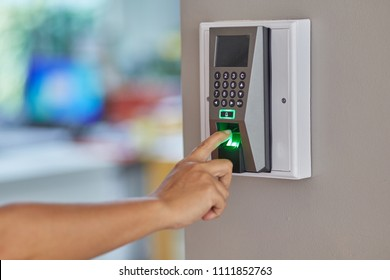 Yong man or woman push fingers down the electronic control machine to access the door