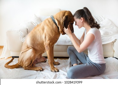 Yong Woman and her dog in home