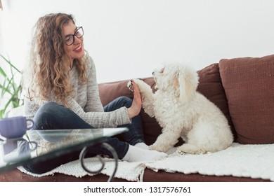 Yong woman kisses her dog