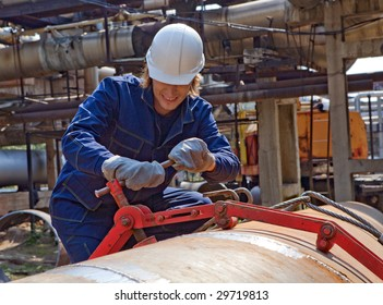 Yong worker in uniform is construction the trunk pipeline