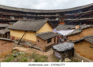 Yongding, Fujian Province / China - Dec 3, 2015: View on the inner structures of a Fujian Tulou (chinese:福建土楼). Traditional houses of the Hakka people. Some tulou offer accomodation for tourists.