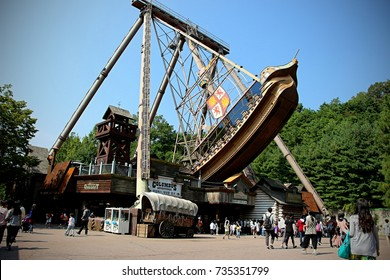 YONGIN, GYEONGGI, SOUTH KOREA - SEPTEMBER 24 - Visitors of Everland Theme Park watch as the Columbus Adventure boat swings on September 24, 2016 in Yongin, Gyeonggi, South Korea