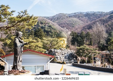 YONGIN, KOREA - FEBRUARY 15,2018: Golden head big Buddha statue at Yunwha Mountain, Wawoo Jeongsa Temple, Yongin at South Korea