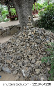 Yongin, Korea - July 05, 2014: Rock pile or cairn set up in front of entrance to ward off disaster or misfortune displayed at a traditional Korean folk village in Yongin, Korea.
